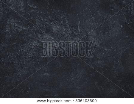 Old grunge black concrete background. Dark texture with space.