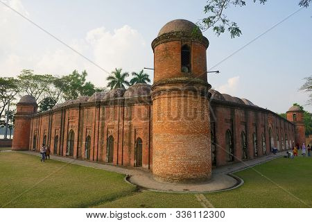 Bagerhat, Bangladesh - February 17, 2014: People Visit Shat Gombuj Mosque In Bagerhat, Bangladesh. S