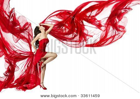 Beautiful Woman Dancing In Red Dress Flying On A Wind Flow on White