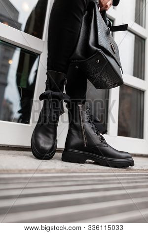 Seasonal Trendy Collection Of Women's Boots. Stylish Young Woman In Fashionable Spring-autumn Black