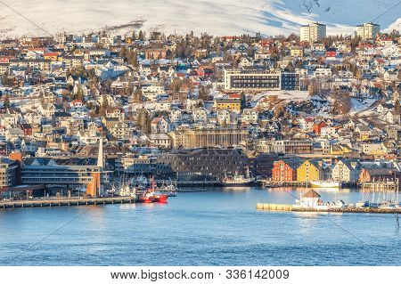 View Over The City Of Tromso And It's Marina In Winter, North Norway