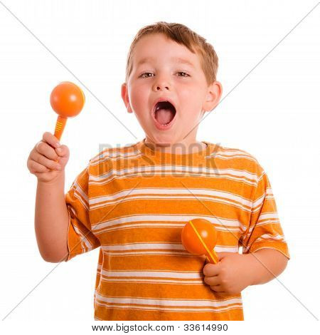 Happy child playing maracas and signing isolated on white