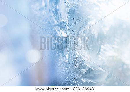 Winter Patterns Holiday Ice Background. Icy Snowflakes. Beautiful Christmas And New Year Christmas B