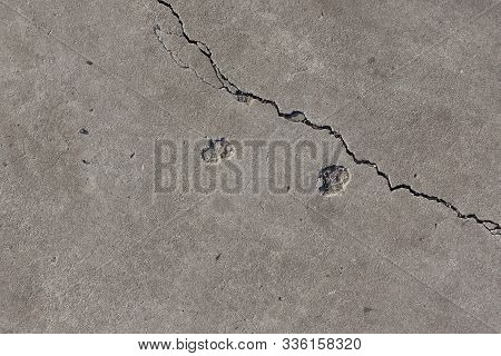 Cleft On Light Grey Concrete Slab From Above