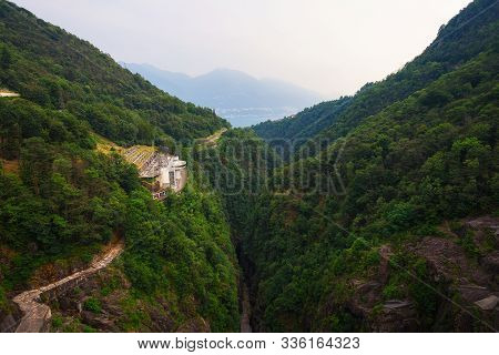 View From The Contra Dam Over A Hydroelectric Power Plant On The Verzasca River In Ticino, Switzerla