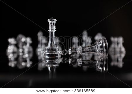 Fallen King. Transparent Methacrylate Chess Pieces On A Black Surface, Fallen King And Queen Standin