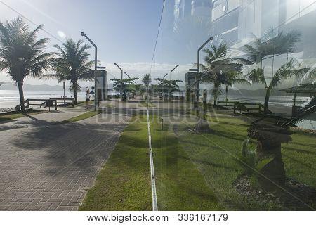Itapema, Santa Catarina, Brazil - November 24, 2019: Young Woman Stretching And Walking In The Walk