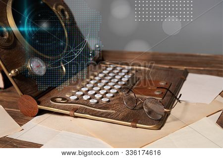 Steampunk Laptop With Data Illustration, Glasses And Documents On Wooden Table Isolated On Grey