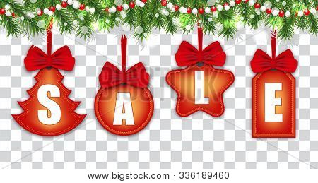 Set Labels For Holiday Christmas Sale And New Year On Ribbons With Red Bows Hanging On Christmas Tre