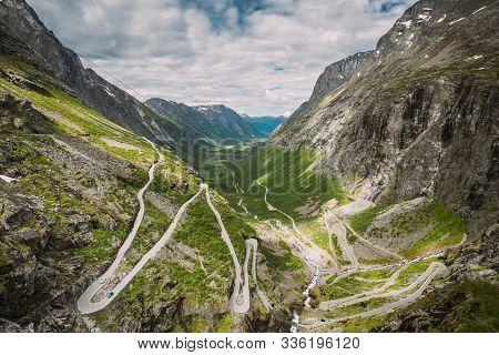 Trollstigen, Andalsnes, Norway. Cars Goes On Serpentine Mountain Road Trollstigen. Famous Norwegian