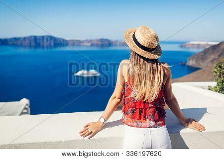 Woman Traveler Looking At Caldera From Fira Or Thera, Santorini Island, Greece. Tourism, Traveling,