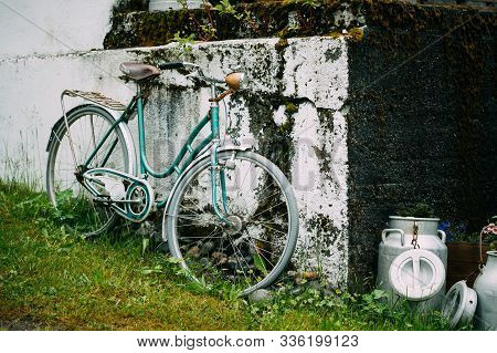 Old Rarity Bicycle Parked Next To Old Wall In Village.