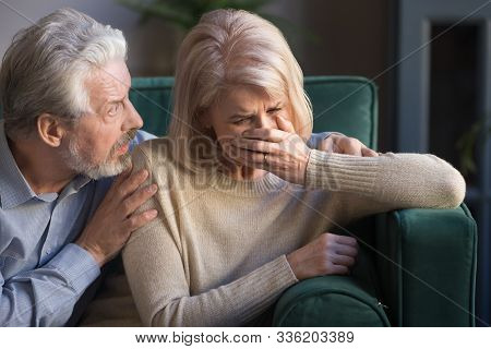 Elderly Spouses Indoors Desperate Wife Crying Worried Husband Comforting Her