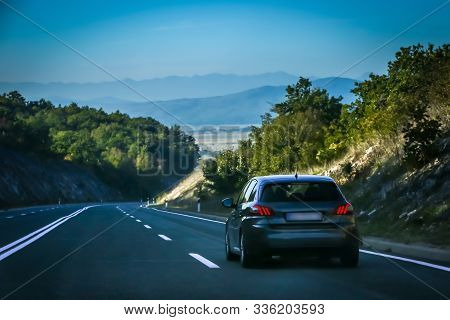 Rear View Of A Car Driving On The Two Way Road With Landscape Of Gorski Kotar In Croatia.