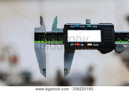 Calipers Modern Digital Measuring Device. Measurement Accuracy. Copy Space.