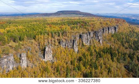 Natural Rock Cliff In Autumn Colored Forrest, Tisa Rocks, Czechia. Aerial Shot.