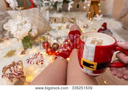 Festive Chirstmas Decorations, Fairy Lights And Hot Cappuccino On A Cosy Fluffy Rug At Christmas Tim