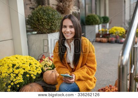 Nice Elated Woman Having Her Smartphone In The Hands