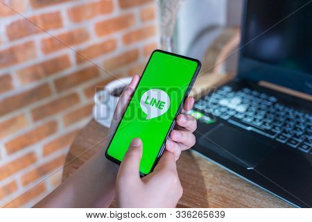 Chiang Mai, Thailand - Oct.18,2019: Woman Holding Xiaomi Mi Mix 3 With Line Apps On Screen. Line Is
