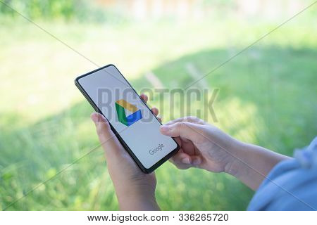 Chiang Mai, Thailand - Oct.18,2019: Woman Hands Holding Xiaomi Mi Mix 3 With Google Drive Apps On Sc