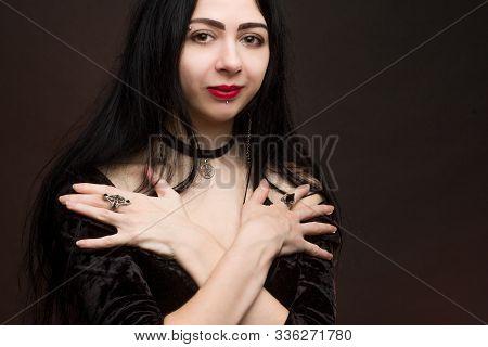 Brunette On Dark Background Dressed In Goth Style