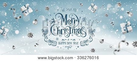 Silver Christmas And New Year Text On Blue Xmas Background With Flying Gift Boxex, Silver Ribbon, De