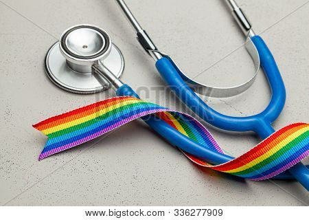 Stethoscope And Lgbt Rainbow Ribbon Pride Symbol. Medical Support After Sex Reassignment Surgery. Gr