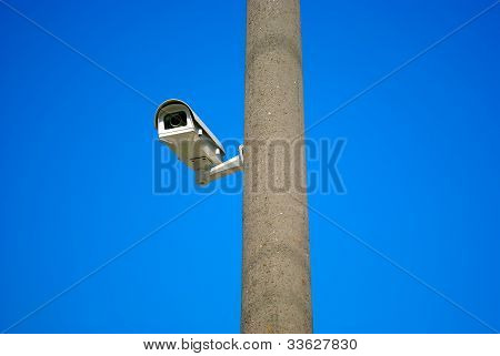 Surveillance Camera On The Gray Column