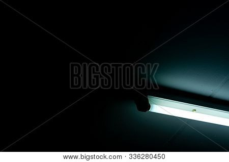 Opened Led Light Tube On Dark Background. Led Fluorescent Lamp Light. Lighting Equipment. Lamp Light