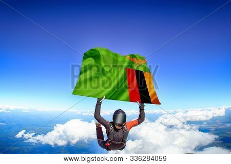 Zambia Extreme. Flag In Skydiving. People In Free Fall Grab Flag Of Zambia. Patriotism, Men And Flag