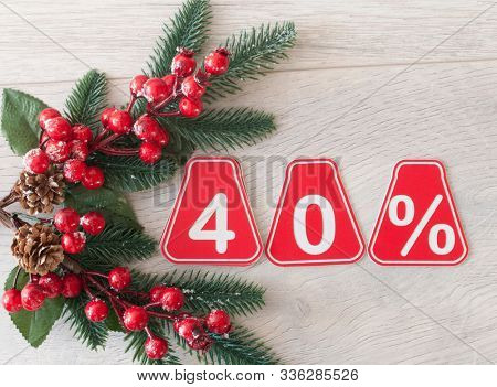 selling 40 percent. Big sale 40%, forty percent on wooden background for flyer, poster, shopping, sign, discount, marketing, sale, banner, website, headline