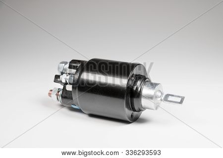 New Black Solenoid For A Starter For A Car On A Gray Gradient Background. Auto Parts. Starter Parts
