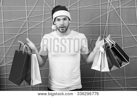 Man Santa With Shopping Bags On Pink Background. Christmas, New Year Gift, Present. Macho Shopper In