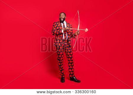 Full Body Photo Of Funny Dark Skin Man Shooting Bow Love Arrow Amour Cupid Good Couple Desire Weddin