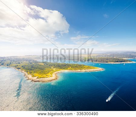 Aerial drone photo of tropical coast. Location Kamenjak reserve, Kvarner bay, Croatia, Europe. Great shot over the sea. Drone photography of popular tourist attraction. Discover the beauty of earth.