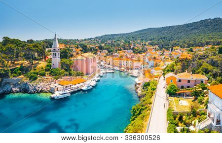 Scenic view of the blue lagoon village Veli Losinj on sunny day. Location place Kvarner Gulf, island Losinj, Croatia, Europe. Drone photography. Summer vacation concept. Discover the beauty of earth.