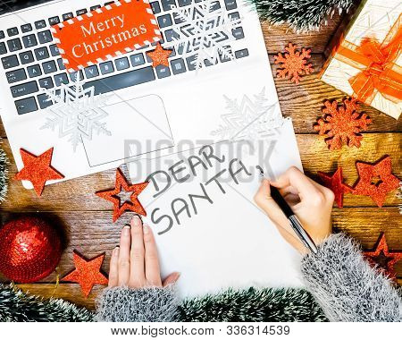 Writing Dear Santa For Christmas. Christmas Letter. Holding Letter For Santa. Christmas Composition