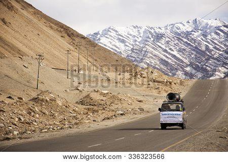 Jammu Kashmir, India - March 20 : Indian Or Tibetan Driver People Driving Van On Leh Manali And Srin