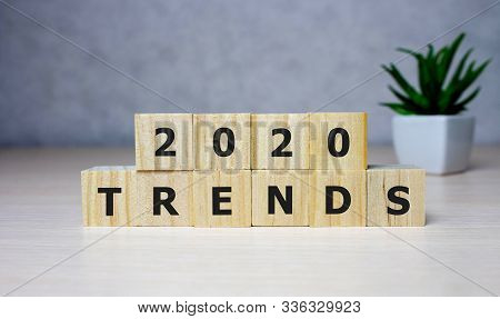 The Word Trends And 2020 On Wooden Cube Block. 2020 Trend Concept
