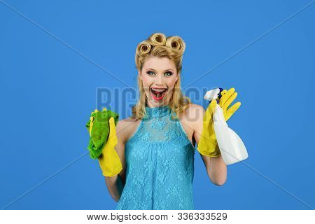 Cleaning service. Cleaning woman. Cleanup. Cleaning tools. Beautiful woman holds duster and spray. Happy retro housewife. Housewife ready for housework. Girl cleaning with rag and bottle spray. poster