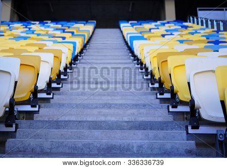 Football Stadium Tribune. Plastic Seats Of The Open Stadium, Close-up. Rows Of Seats For Spectators