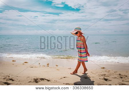 Cute Little Girl Walk On Tiptoes On Summer Beach Vacation