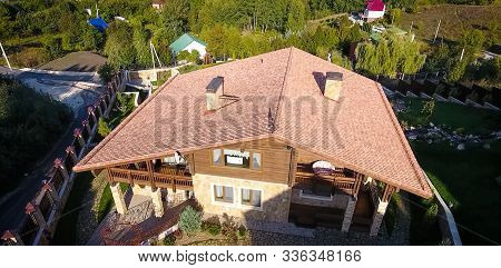 House With A Ceramic Tile Roof. Cement-sand Roof Tiles.
