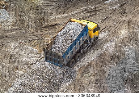 truck unloads shipping transportation rubble rock gravel to the ground poster