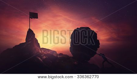 Determined Businessman Pushing A Huge Boulder Up A Hill Reaching Finish Flag For Mission Accomplishm