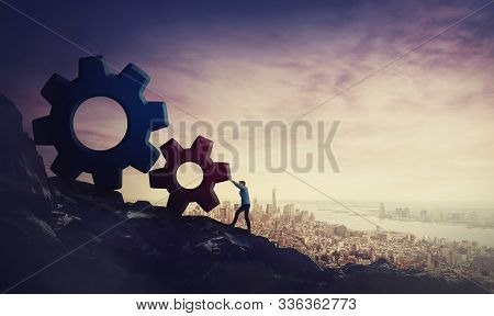 Surreal Scene Determined Businessman Pushing Big Cog Wheels Uphill. Business Concept, Hard Working F