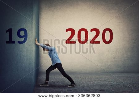 Conceptual Scene As A Confident Person Pushing The 2019 Old Wall To Make Space For The Coming New 20