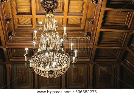 Decorated Chandelier Hangs In The Entrance Hall At Odessa Philharmonic. Historical Large Three Level