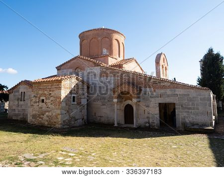 Apollonia, Albania - September 27, 2019: Stone And Brick Facade With Arched Doorway And Dome Of The