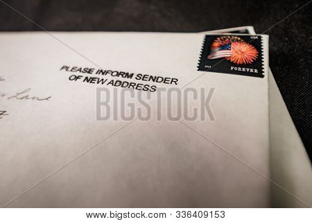 White Envelope With Change Of Address Stamp
